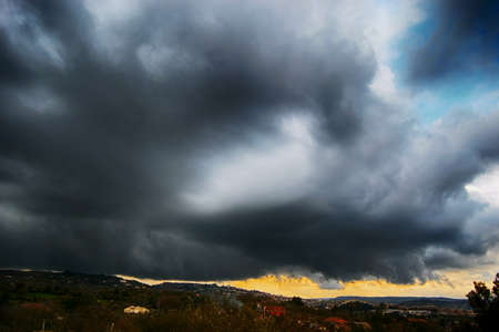 Light in the dark and dramatic storm clouds background. Storm clouds. Supercell Storm Cumulonimbus Stok Fotoğraf - 160745549