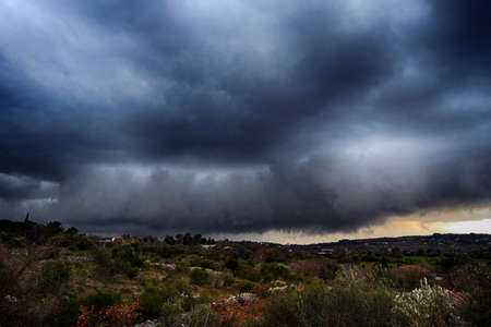 Light in the dark and dramatic storm clouds background. Storm clouds. Supercell Storm Cumulonimbus Stok Fotoğraf