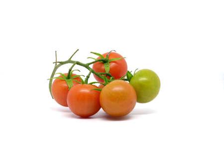 Close up of fresh cherry tomato isolated on white background. Stok Fotoğraf