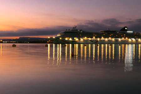 Cruise ship docked at the port at sunset