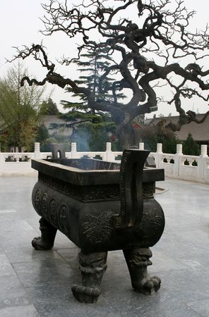 ancient incense burner at the temple courtyard Imagens