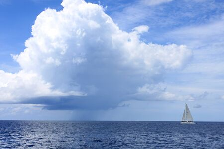 Rain clouds over the Caribbean Sea and a sail boat