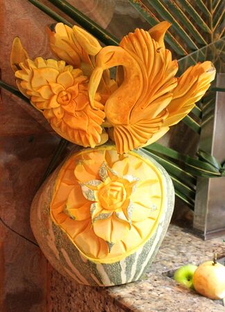 Bird sculpted in melon on buffet display