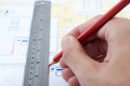 drawing a house plan with pencil and ruler Stock Photo - 9326587