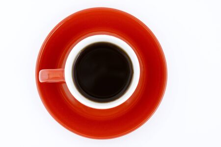red coffe mug and plate upper view with black coffee on white background