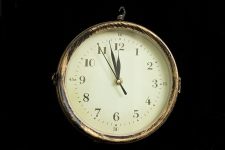 reloj mostrando cerca de la medianoche sobre fondo blanco Foto de archivo - 9308225