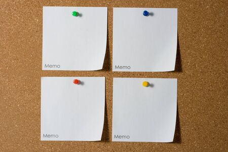 billboard posting: four reminders with colored thumbtack Stock Photo