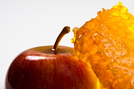 apple and honeycomb closeup on  white background photo