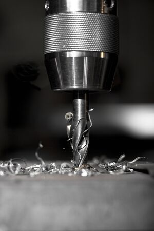 swarf: sharp metal dill in action drilling a hole in a metal plate