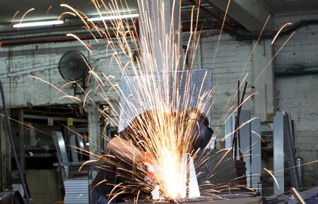 sparks frying over the working table during metal grinding Stock Photo - 9313040