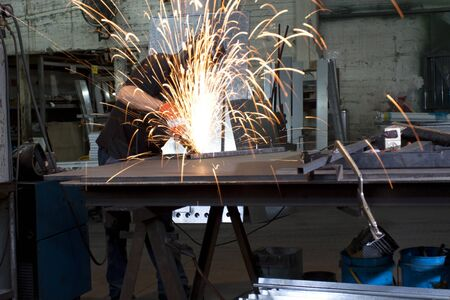 sparks frying over the working table during metal grinding Stock Photo - 9309785