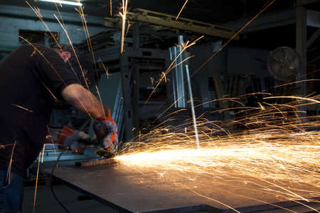 sparks spread all over from metal grinding action  Stock Photo - 9313391