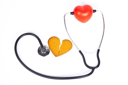 healing a broken heart with  a sthethoscope on white background photo