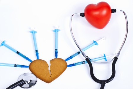 healing a broken heart with blue sirenge and a stethhoscope photo