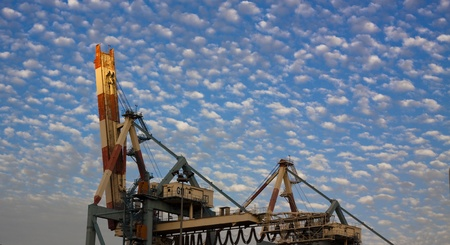 port crane with blue cloudy sky at sunset Stock Photo - 9313658