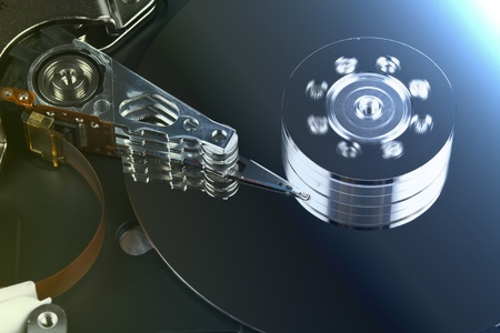 harddrive: open spinig hard drive closeup on reading head Stock Photo