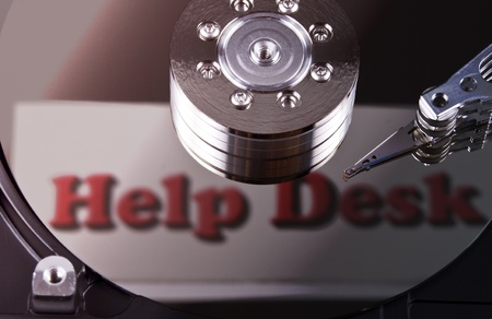 help desk inscripton reflecten on a hard drive disks photo