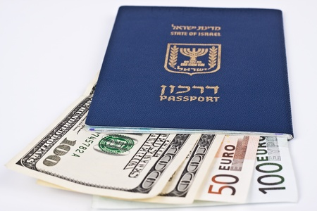 israel passport: israeli passport and dollar bills isolated on white with cliping path