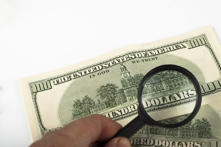 dollars word in a magnifing glass one hundred dollar bill Stock Photo - 9313346