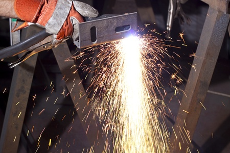 sparks made while plasma cutting  steel plate Stock Photo - 9312762