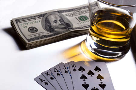 poker playing cards dollars and a whiskey glass Stock Photo - 9313301