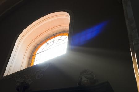 church window: ray  of light trugh an old  church window