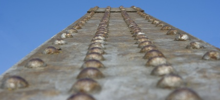 rusted iron bridge closeup on blue sky background Stock Photo - 9303597