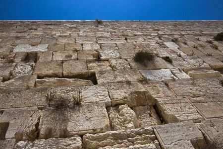 the western wall in jerusalem and blue sky Stock Photo