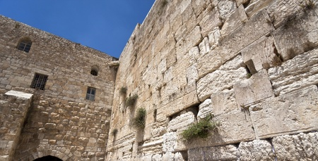 a corner of the western wall in jerusalem with some blue sky