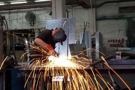 sparks during working with steel in the factory photo