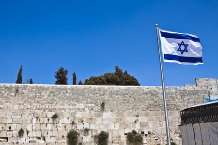 israelian flag with the western wall in the background  and blue sky photo