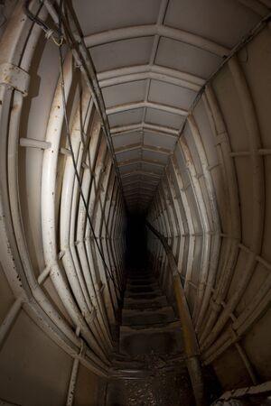 underground bunker entrance tunnel stairway metall walls photo