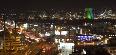 panorama night view over rafinary comercial center and highway photo