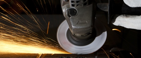 closeup to a grinder sparks all over wide landscape image Stock Photo
