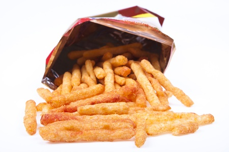 spicy french fries snacks in a abag on white background photo