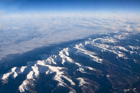 rocky mountains covered with snow aerial view from airplane Stock Photo - 9311228