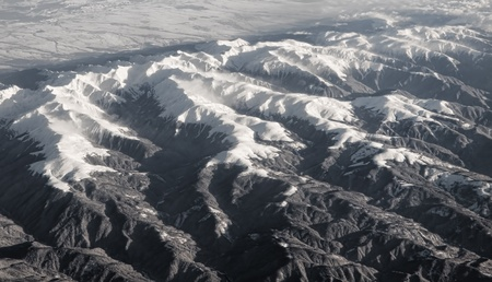 rocky mountains covered with snow aerial view Stock Photo - 9310511