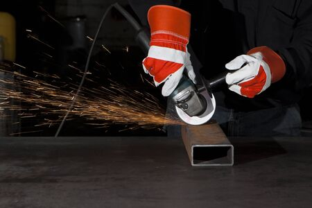 orange sparks during metal grinding in a steel factory Stock Photo - 9310263