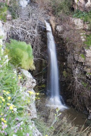 tall water fall with white water like a courtain and brown rocks around Stock Photo - 9310663