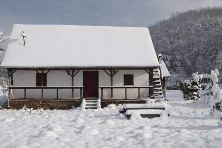 log cabin in the forest covered with fresh snow  photo
