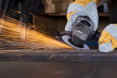 mteal grinding with orange flying sparks Stock Photo