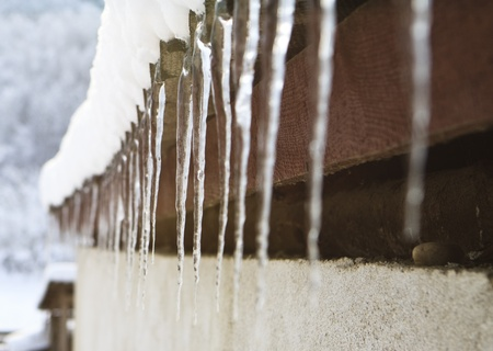 icicle on the roof edge in the cold winter Stock Photo - 9735676