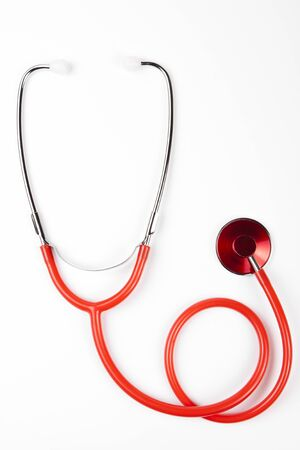 single red shiny stethoscope on white background Stock Photo - 9735670