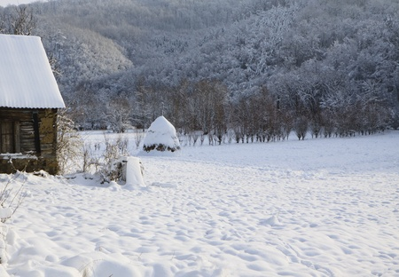 log cabin in the forest covered with fresh snow Stock Photo - 9735730