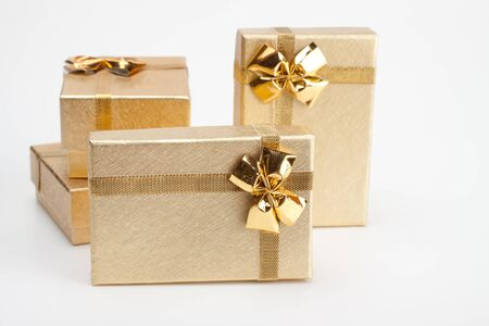 4 golden jewelry box isolated on white background photo