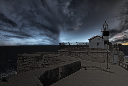 Lighhouse at the end of ancient wall at dusk Stock Photo - 10055725