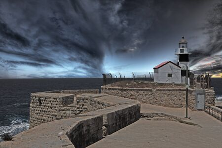 Lighhouse at the end of ancient wall at dusk Stock Photo - 10055731