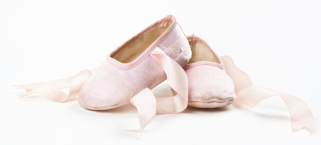pink baby balerina shoes isolated on wite background photo