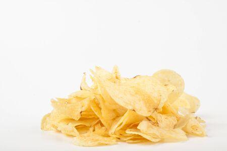 yelow potato chips pile isolated on white background photo
