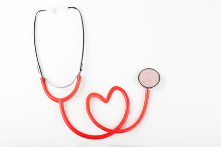 clean heart: single red stethoscope isolated on white background Stock Photo
